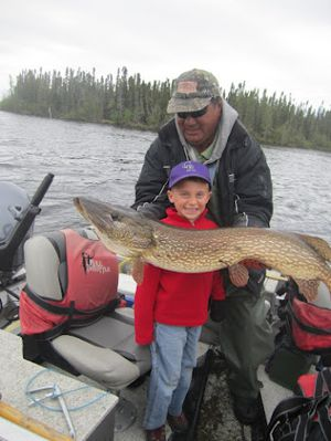 Seven year old Cody Morris with trophy Pike from Silsby Lake