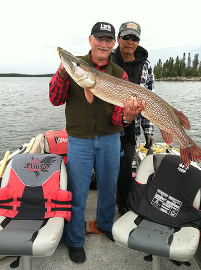 "Denny Zahrbock with 46"" Pike from Silsby Lake in late August"