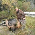 Matt Hammersmith with a bull Moose during the first hunt in 2012 on Cuddle Lake
