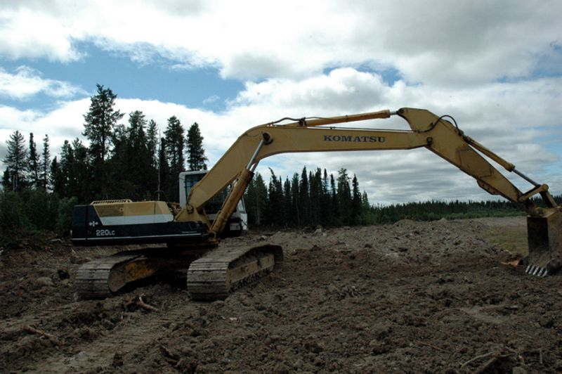 Our 52,000 lb. Komatsu excavator makes short work of sidecasting clay ontot he airstrip