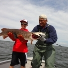 Mason Thimjon gets help holding his massive 45 inch Master Angler in mid July