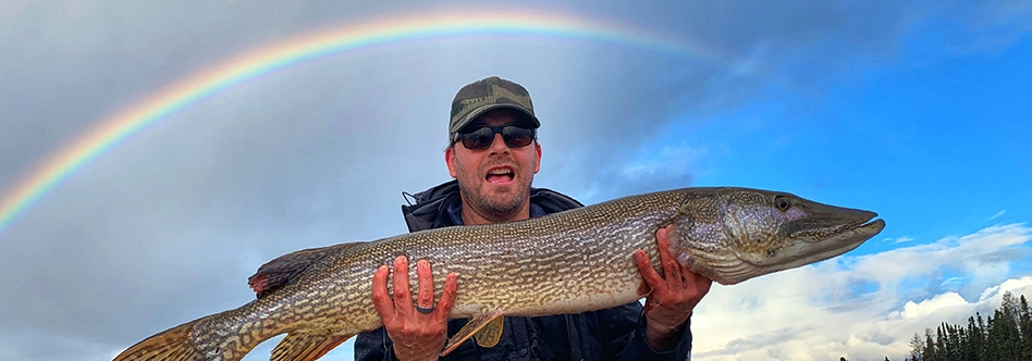 Perfect timing!  Catching a trophy Pike under the Rainbow!