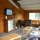 The lounge in the main lodge with flat screen TV, WIFI, satellite phone, printer, scanner and copier